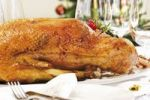 Thumbnail Roast goose on a festively decorated table