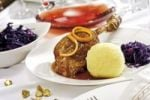 Thumbnail Goose-leg, red cabbage, potato dumpling on a festively decorated table