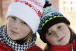 Thumbnail Two sisters, 9 and 12 years old, with woollen hats, outside