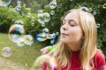 Thumbnail Girl, 13 years, with soap bubbles