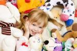 Thumbnail Smiling blond little girl, 4 years, with plushy animals