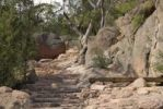 Thumbnail Footpath with stone steps through the red granite rocks of the Hazards Range, Freycinet Peninsula, Tasmania, Australia