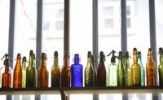 Thumbnail Coloured bottles on a shelf