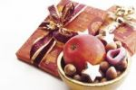 Thumbnail Wrapped Christmas gift or present and bowl of goodies and biscuits