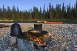 Thumbnail Pot, pan, cooking on the camp fire, canoes behind, gravel bar, Liard River, British Columbia, Yukon Territory, Canada, North America