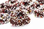 Thumbnail Fudge rings covered in chocolate and sprinkles or hundreds-and-thousands, sweet Christmas tree decoration