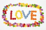 Thumbnail Coloured confectionary forming the word LOVE