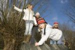 Thumbnail Group of little girls, 6 to 11 years, climbing on tyres