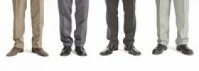 Thumbnail Four businessmen standing in a row, detail of legs