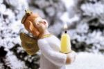 Thumbnail Angel holding a candle in a snowy forest