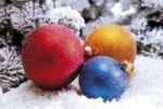Thumbnail Colourful Christmas tree baubles in a snowy forest