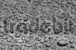 Thumbnail Black-and-white structure by raindrop on a bistro table, macro