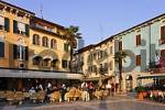 Thumbnail a plaza with restaurants at sunset Sirmion, e Lake Garda, Italy