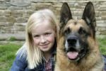 Thumbnail Blonde girl with German shepherd