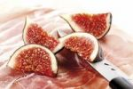 Thumbnail Figs Ficus carica, fresh fruit on raw ham