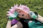 Thumbnail Female gardener with paper flower and straw hat in the sunlight