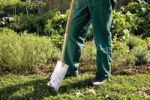 Thumbnail Gardeners legs with spade