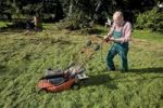 Thumbnail Gardener with lawnmower