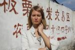 Thumbnail Young woman in front of a wall with chinese lettering on it