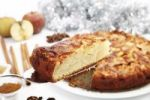Thumbnail Christmas apple pie with fresh apples, cinnamon, sticks of cinnamon and sugar on a pie server