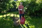 Thumbnail man cuts up garden wastes with shredder