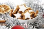 Thumbnail Cinnamon flavored star-shaped biscuits, christmas decorations, Cinnamon sticks, slices of orange and christmas tree balls