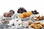 Thumbnail Assortment of christmas biscuits in bowls, cinnammon star-shaped biscuits, gingerbread, vanilla biscuits, chocolate gingerbread biscuits, spiced biscuits, dominos, christmas decorations and christ