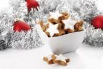 Thumbnail Cinnamon flavored star-shaped biscuits in a white bowl, christmas tree balls and decoration