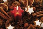 Thumbnail Lit candle and Christmas decoration