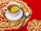 Thumbnail Cup and saucer with tea and lemon