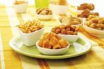 Thumbnail Various spiced snacks in bowls, crisps, peanut flips, potato sticks, roasted peanuts and potato rings