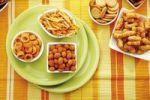 Thumbnail Various spiced snacks in bowls, crisps, peanut flips, potato sticks, roasted peanuts, pretzel sticks and potato rings