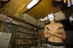 Thumbnail Young man wearing a mask and holding two pistols in a shop, Tokyo, Japan, Asia