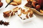Thumbnail Star-shaped cinnammon biscuits, cinnammon sticks and christmas dainties