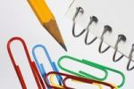 Thumbnail Colored paper clips, pencil and spiral notebook, detail