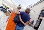 Thumbnail Young couple arm in arm, walking through Hvar, Damatia, Croatia, Europe