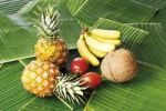Thumbnail Tropical fruits on bed of banana leaves, baby pineapples, Ananas comusus, tamarillos, Solanum betaceum, coconuts Cocos nucifera and baby bananas Musaceae