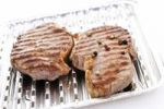 Thumbnail Rump steak with grill marks in an aluminium tray