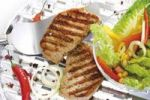 Thumbnail Pork loin steak with grill marks in an aluminium tray, mixed salad in a glass bowl
