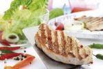 Thumbnail Pork loin steak on a spatula, mixed salad in a glass bowl