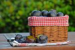 Thumbnail Basket of fresh plums