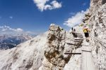 Thumbnail Climber climbing along the Via Ferrata Ivano Dibona climbing route on Monte Cristallo to the summit of Cristallino, Dolomites, Belluno, Italy, Europe /