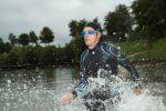 Thumbnail Triathlete running through water, Aichstruter Reservoir Welzheim, Baden-Wuerttemberg, Germany, Europe