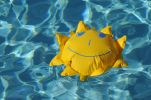 Thumbnail Toy sun floating in a swimming pool