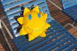 Thumbnail Toy sun lying on a sun lounger