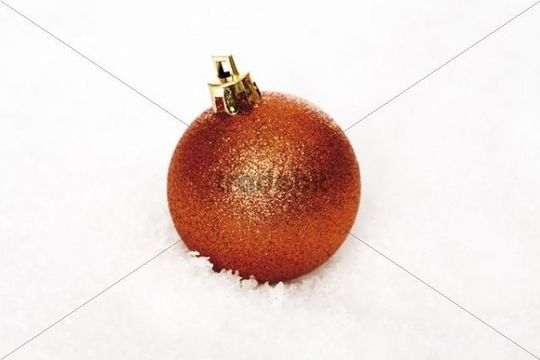 Red Christmas tree ball in snow