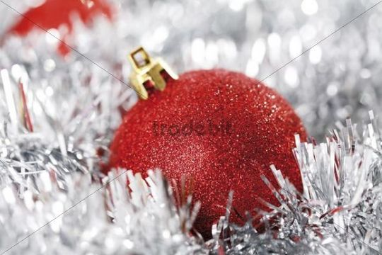 Red glitter Christmas tree ball with Christmas decorations