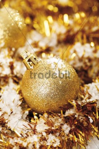 Gold glitter Christmas tree balls with Christmas decorations