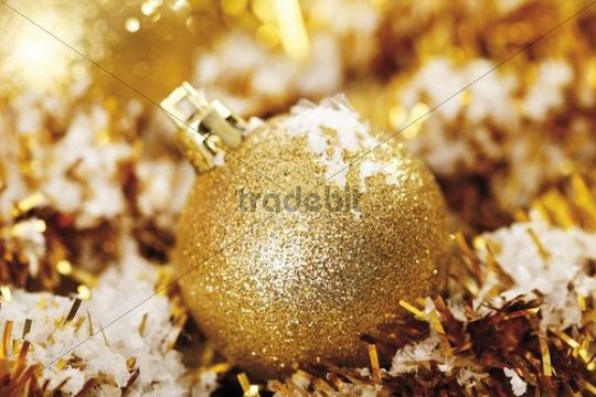 Gold glitter Christmas tree ball with Christmas decorations