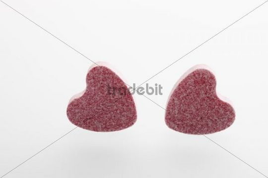 Two pink heart-shaped grape sugars
